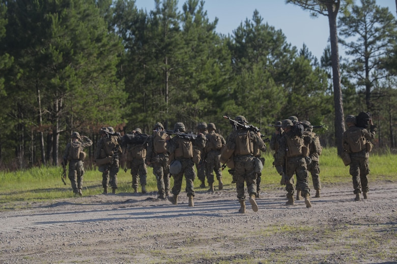 Marines with 3rd Battalion, 6th Marine Regiment consolidate after conducting an objective raid at Landing Zone Cardinal at Camp Lejeune, N.C., June 10, 2016. The battalion conducted a Marine Corps Combat Readiness Evaluation from June 6-10 in preparation for an upcoming deployment. The MCCRE, a week-long evaluation exercise, tests the Marines on operation readiness in a deployed environment.