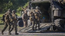 Marines with 3rd Battalion, 6th Marine Regiment rally their wounded into the back of an amphibious assault vehicle during a raid at Marine Corps Base Camp Lejeune, North Carolina, June 9, 2016. Throughout the week, the battalion was tested on their operational readiness as part of the Marine Corps Combat Readiness Evaluation.