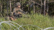 Private First Class Casin Mullinex and Lance Cpl. Shaun Carnley, machine gunners with 3rd Battalion, 6th Marine Regiment, set up defensive security after capturing Landing Zone Cardinal from the enemy during the final raid of the Marine Corps Combat Readiness Evaluation at Marine Corps Base Camp Lejeune, North Carolina, June 9, 2016. The MCCRE tests the Marines on their ability to operate as a whole and is the final exercise as a battalion during pre-deployment training.