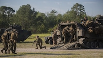 Marines with 3rd Battalion, 6th Marine Regiment buddy carry their wounded off of the battlefield during an objective raid at Marine Corps Base Camp Lejeune, North Carolina, June 9, 2016. The battalion conducted a Marine Corps Combat Readiness Evaluation from June 6-10 in preparation for an upcoming deployment.