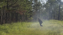 A Marine with 3rd Battalion, 6th Marine Regiment uses the cover of smoke from a simulation artillery round to move into the tree-line during the battalions' Marine Corps Combat Readiness Evaluation, at Marine Corps Base Camp Lejeune, North Carolina, May 10, 2016. The MCCRE, a pre deployment exercise, tests the Marines on operational readiness and their ability to operate as a whole.