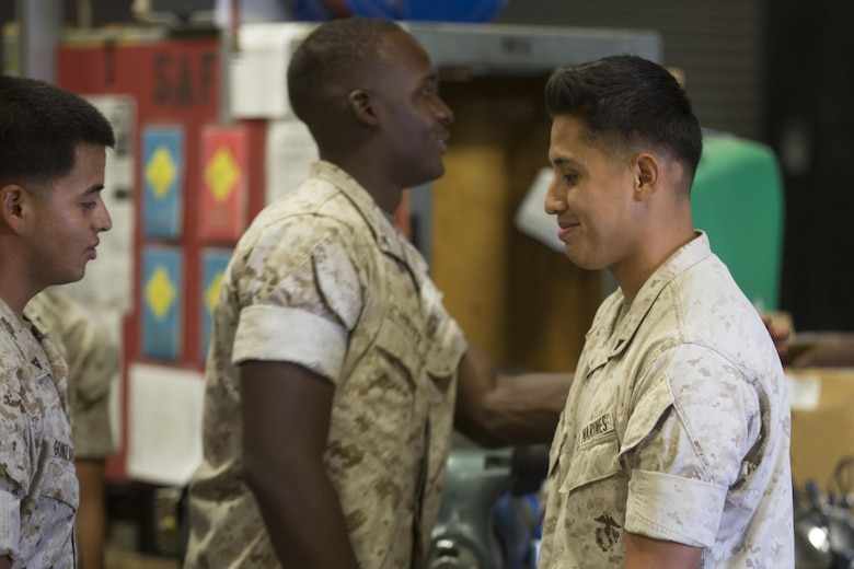 Lance Cpl. Edwin Salgado, motor transport operator, 7th Marine Regiment, is congratulated by fellow Marines after receiving the Road Warrior Award in building 1951 aboard Marine Corps Air Ground Combat Center Twentynine Palms, Calif., June 2, 2016. The award is presented to any military or government civilian employee who operates government motor vehicles and achieves mishap or violation-free driving in 2,500-mile increments. (Official Marine Corps photo by Cpl. Medina Ayala-Lo/ Released)