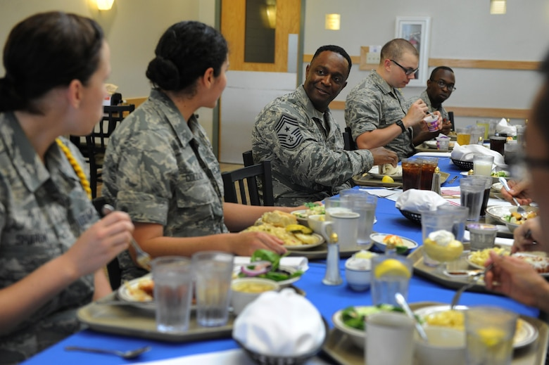 Chief Master Sgt. Calvin Williams, Air Force Global Strike Command command chief master sergeant, has lunch with 81st Training Group Airmen leadership at the Azalea Dining Facility June 10, 2016, Keesler Air Force Base, Miss. Williams also received mission briefings from 2nd Air Force and the 85th Engineering Installation Squadron during his site visit. (U.S. Air Force photo by Kemberly Groue)