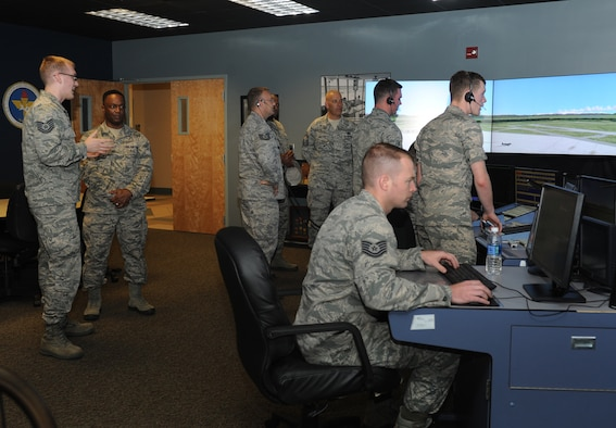 Tech. Sgt. William Olson, 334th Training Squadron instructor, shows Chief Master Sgt. Calvin Williams, Air Force Global Strike Command command chief master sergeant, the air traffic control tower simulator at Cody Hall June 10, 2016, Keesler Air Force Base, Miss. Williams also received mission briefings from 2nd Air Force and the 85th Engineering Installation Squadron during his site visit. (U.S. Air Force photo by Kemberly Groue)