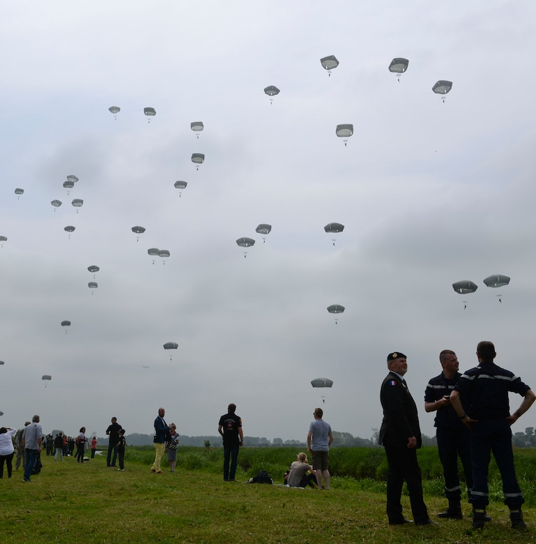 Paratroopers from the U.S., France and Germany participate in a D-Day remembrance jump June 5, 2016 at Sainte Mere- Eglise, France. More than 380 service members from Europe and affliated D-Day historical units participated in the 72nd anniversary as part of Joint Task Force D-Day 72. Members of the 314th Airlift Wing were part of the Task Force, based in Sainte Mere-Eglise, which supported events across Normandy, from May 30 - June 6 to commemorate the selfless actions by all the allies on D-Day that continue to resonate 72 years later. (U.S. Air Force photo by Senior Airman Mercedes Taylor)