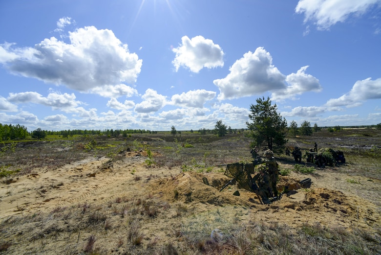 NATO forces await an attack from opposing forces during a training exercise June 13, 2016, at Adazi Military Training Base, Latvia.  U.S. forces and NATO partners are in Europe participating in Saber Strike 16; a long-standing, U.S. Joint Chiefs of Staff-directed, U.S. Army Europe-led cooperative-training exercise, which has been conducted annually since 2010.  SbS16 rapidly deploys personnel across the Baltic region, ensuring allied and partnered nations are able to quickly assemble and train anywhere they are called to do so. (U.S. Air Force photo/Senior Airman Nicole Keim)