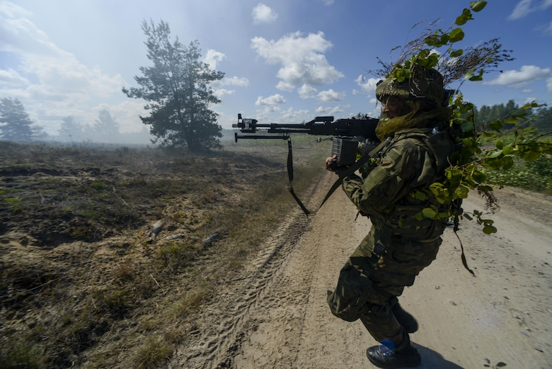 A Norwegian soldier attacks opposing forces during a training exercise June 13, 2016, at Adazi Military Training Base, Latvia.  U.S. forces and NATO partners are in Europe participating in Saber Strike 16; a long-standing, U.S. Joint Chiefs of Staff-directed, U.S. Army Europe-led cooperative-training exercise, which has been conducted annually since 2010.  Our presence in Europe and the relationships built over the past 70 years provide the U.S. strategic access critical to meet our NATO commitment to respond to threats against our allies and partners. (U.S. Air Force photo/Senior Airman Nicole Keim)