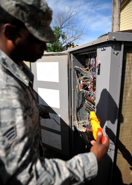 Senior Airman Lecassius Boyle, 9th Civil Engineer Squadron Heating, Ventilation and Air Conditioning (HVAC) technician, checks the electrical current going to the unit May 23, 2016, at Beale Air Force Base, California. HVAC technician's install, operate, maintain, and repair heating, ventilation, air conditioning, and refrigeration (HVAC/R) systems, combustion equipment, and industrial air compressors. In addition, they also maintain and repair non-electric kitchen equipment. (U.S. Air Force photo by Staff Sgt. Jeffrey Schultze)