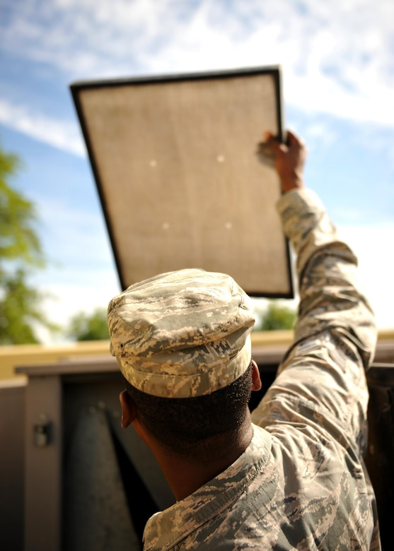 Senior Airman Lecassius Boyle, 9th Civil Engineer Squadron Heating, Ventilation and Air Conditioning (HVAC) technician, checks an air filter on a unit May 23, 2016, at Beale Air Force Base, California. HVAC technician's install, operate, maintain, and repair heating, ventilation, air conditioning, and refrigeration (HVAC/R) systems, combustion equipment, and industrial air compressors. In addition, they also maintain and repair non-electric kitchen equipment. (U.S. Air Force photo by Staff Sgt. Jeffrey Schultze)