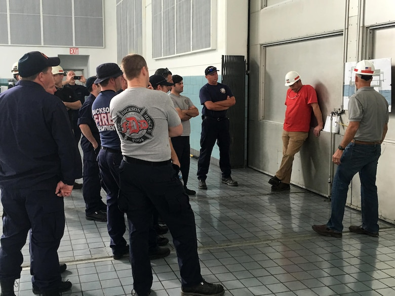 U.S. Army Corps of Engineers Nashville District employees, Ashland City Fire Department fire fighters, and Dickson County Fire Department fire fighters learn about the layout of the Cheatham Dam Powerhouse during a confined space rescue training exercise at the facility in Charlotte, Tenn., May 24, 2016.