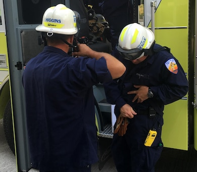 Ashland City fire rescue personnel get their gear on and prepare to participate in a confined space rescue training exercise at the Cheatham Dam Powerhouse in Charlotte, Tenn., May 24, 2016.