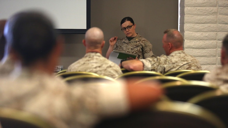 "Maj. Misty Posey the Plans Officer with the Manpower Integration Office, Headquarters Marine Corps, educates an audience about the integration of female Marines into previously closed combat arms occupations and units at the Unit Event Center June 8, 2016. The goal of integration education training is to ensure commanders and staffs are sufficiently educated and prepared to receive Marines of either gender by October 31, 2016 (active) and January 31, 2017 (reserve). ""I hope we get to the point where people look at female Marines as Marines first and as women second,"" Posey said."