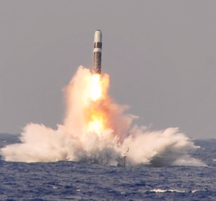 "ATLANTIC OCEAN (June 2, 2014) - A Trident II D-5 ballistic missile launches from the Ohio-class ballistic missile submarine USS West Virginia (SSBN 736) during a missile test at the Atlantic Missile Range. Two years later – on June 2, 2016 – Navy Strategic Systems Programs (SSP) Director Vice Adm. Terry Benedict presented the SSP Director's Award to Naval Surface Warfare Center Dahlgren Division (NSWCDD) senior scientist Kim Payne for leadership impacting the Fleet Ballistic Missile Program. Payne was honored for her expertise in fire control software and targeting models as well as quality assurance methodology enhancements to improve Fleet Ballistic Missile deployed software product effectiveness and efficiency. Benedict said her efforts, ""directly contributed to the Fleet Ballistic Missile Program and successful SSGN (Ohio-class guided-missile submarine) conversion software initiatives.""  (U.S. Navy photo/Released)"