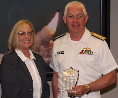 "WASHINGTON (June 2, 2016) Navy Strategic Systems Programs (SSP) Director Vice Adm. Terry Benedict presents the SSP Director's Award to Naval Surface Warfare Center Dahlgren Division (NSWCDD) senior scientist Kim Payne for leadership impacting the Fleet Ballistic Missile Program. Payne was honored for her expertise in fire control software and targeting models as well as quality assurance methodology enhancements to improve Fleet Ballistic Missile deployed software product effectiveness and efficiency.  Benedict said her efforts, ""directly contributed to the Fleet Ballistic Missile Program and successful SSGN (Ohio-class guided-missile submarine) conversion software initiatives.""  (U.S. Navy photo/Released)"
