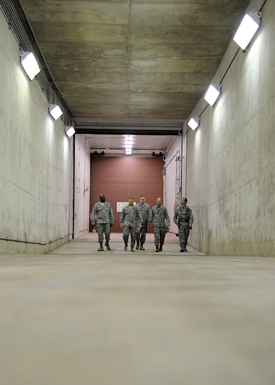 Leadership from the 319th Air Base Wing and 10th Space Warning Squadron walk up the exit ramp June 11, 2016, on Cavalier Air Force Station, N.D. Community members were given the opportunity to tour the Perimeter Acquisition Radar Attack Characterization System during the Cavalier AFS open house. (U.S. Air Force photo by Senior Airman Ryan Sparks/Released)