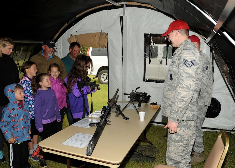 Combat arms instructors from the 319th Security Forces Squadron show local community members a variety of weapons June 11, 2016, on Cavalier Air Force Station, N.D. The 10th Space Warning Squadron hosted an open house to allow the community to see what the installation does on a regular basis. (U.S. Air Force photo by Senior Airman Ryan Sparks/Released)
