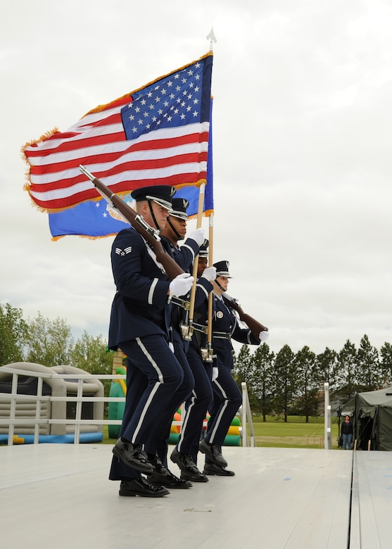 The 319th Air Base Wing Honor Guard presents the colors June 11, 2016, on Cavalier Air Force Station, N.D. The presentation of the colors marked the official beginning of the Cavalier AFS Open House. (U.S. Air Force photo by Senior Airman Ryan Sparks/Released)