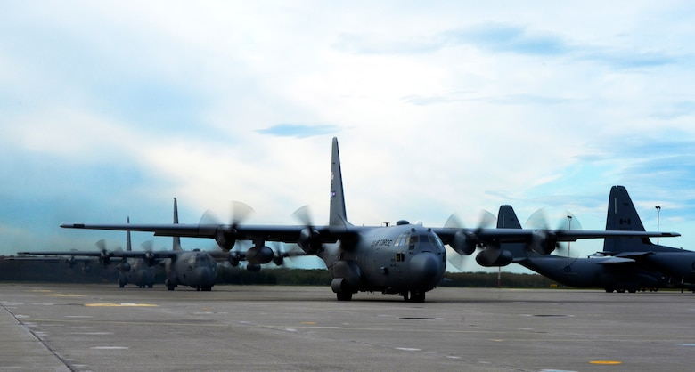 Three C-130 Hercules aircraft, two from the 94th Airlift Wing, Dobbins Air Reserve Base, Georgia, and one Kentucky Air National Guard prepare for takeoff at the Air Force Tactical Training Center in Cold Lake, Alberta, Canada, on June 3, 2016, in route to the air weapons range during Maple Flag 49. The 4,478-square-mile range is used to train allied forces for tactical global operations, while fostering multi-national coordination and cooperation. (U.S. Air Force photo/Master Sgt. James Branch)