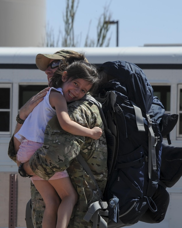 U.S. Air Force Tech. Sgt. Paul, assigned to the 48th Rescue Squadron, greets his daughter after returning home from a 4-month-long deployment at Davis-Monthan Air Force Base, Ariz., June 8, 2016. Two of the three 48th RQS rescue teams, as well as a support team, returned back from a 4-month-long deployment to Turkey. (U.S. Air Force photo by Airman 1st Class Mya M. Crosby/Released)