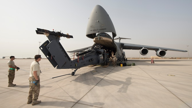 A HH-60G Pave Hawk is off-loaded from a C-5M Super Galaxy May 30, 2016, at Camp Lemonnier, Djibouti. During its mission while circumnavigating the world, this C-5M transported more than 580 thousand pounds of cargo and 398 passengers. (U.S. Air Force photo/Senior Airman Zachary Cacicia)