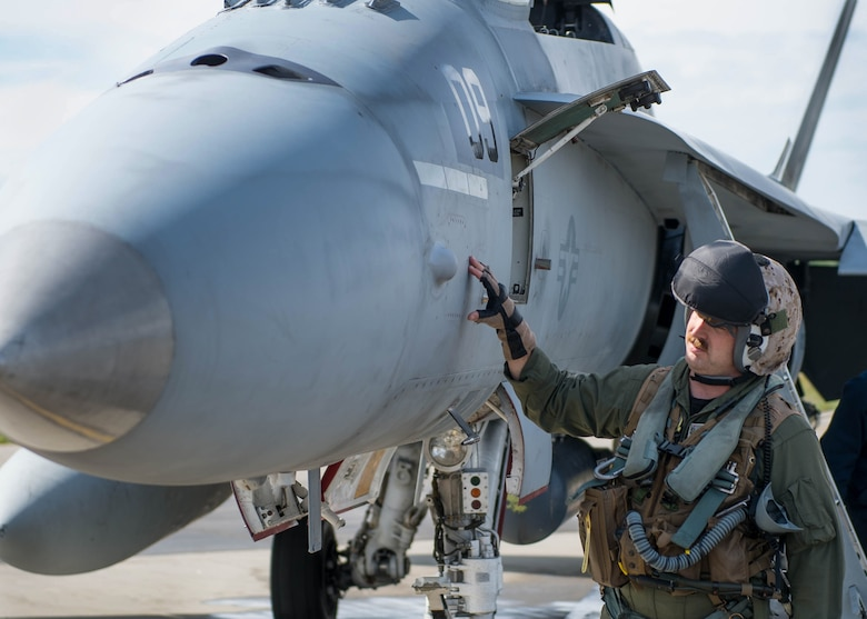 U.S. Marine Corps Stephen Morrison, a Marine Fighter Attack Squadron 314 quality assurance officer, prepares to fly a sortie June 10, 2016, in the number nine jet, which is holds the highest flying hours in the U.S. Marine Corps F-18A Hornet inventory, during RED FLAG-Alaska (RF-A) 16-2. RF-A enables joint and international units to sharpen their combat skills by flying simulated combat sorties in a realistic threat environment, which allows them to exchange tactics, techniques and procedures while improving interoperability. (U.S. Air Force photo by Staff Sgt. Shawn Nickel/Released)