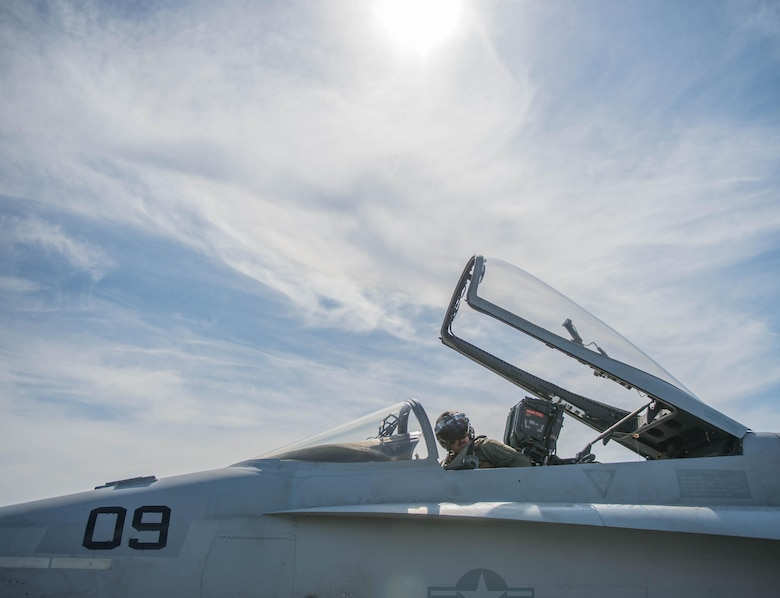 U.S. Marine Corps Stephen Morrison, a Marine Fighter Attack Squadron (VMFA) 314 quality assurance officer, prepares for a June 10, 2016, sortie in the Joint Pacific Alaska Range Complex (JPARC) flying in the number nine jet, which holds the highest flying hours in the U.S. Marine Corps F-18A Hornet inventory, during RED FLAG-Alaska (RF-A) 16-2. The exercise provides unique opportunities to integrate various forces into joint, coalition and multilateral training scenarios from simulated forward operating bases in the JPARC, which at more than 67,000 square miles, is the largest instrumented air, ground and electronic combat training range in the world. (U.S. Air Force photo by Staff Sgt. Shawn Nickel/Released)