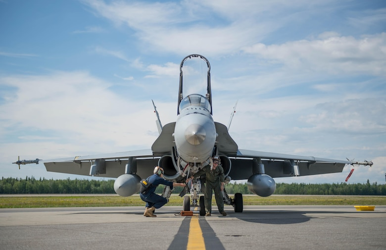 U.S. Marine Corps maintenance technicians from Marine Fighter Attack Squadron (VMFA) 314 based out of Miramar, Calif., prepare their number nine jet, June 10, 2016, which holds the highest flying hours in the U.S. Marine Corps F-18A Hornet inventory, during RED FLAG-Alaska (RF-A) 16-2. RF-A enables joint and international units to sharpen their combat skills by flying simulated combat sorties in a realistic threat environment, which allows them to exchange tactics, techniques and procedures while improving interoperability. (U.S. Air Force photo by Staff Sgt. Shawn Nickel/Released)