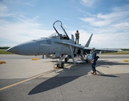 U.S. Marine Corps Stephen Morrison, a Marine Fighter Attack Squadron 314 quality assurance officer, and Lance Cpl. Chance Ison prepare the unit's number nine jet, which is holds the highest flying hours in the U.S. Marine Corps F-18A Hornet inventory, for a sortie June 10, 2016, during RED FLAG-Alaska 16-2. The exercise provides unique opportunities to integrate various forces into joint, coalition and multilateral training from simulated forward operating bases. (U.S. Air Force photo by Staff Sgt. Shawn Nickel/Released)