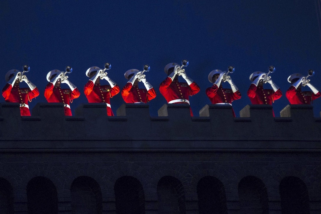The U.S. Marine Drum and Bugle Corps performs during an evening parade at Marine Barracks Washington, D.C., June 10, 2016. Marine Corps Lt. Gen. Michael G. Dana, deputy commandant for installations and logistics, hosted the event, and U.S. Sen. Maize Hirono of Hawaii was the guest of honor. Marine Corps photo by Cpl. Chi Nguyen
