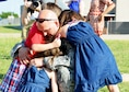 Master Sgt. Shaun Erickson of the 507th Aircraft Maintenance Squadron hugs three of his children June 11, 2016, at Tinker Air Force Base, Okla., following his return from a four-month deployment to Southwest Asia. Reservists in the 507th Air Refueling Wing fly three to four missions daily and off-load millions of pounds of fuel in support of operations worldwide. (U.S. Air Force photo/Tech. Sgt. Lauren Gleason)