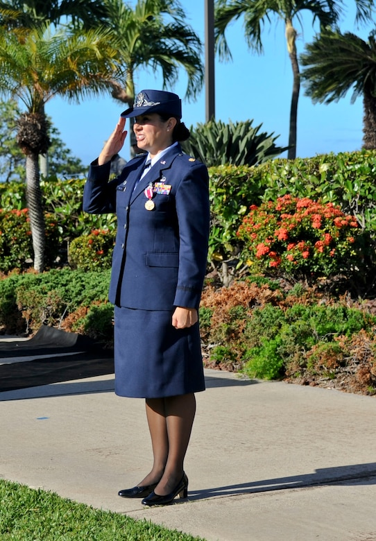 Maj. Dorinda Mazza, outgoing 15th Comptroller Squadron commander, renders one final salute before handing over command of the squadron to Maj. Andrew Gmytrasiewicz in a change-of-command ceremony at the Missing Man Formation June 10, 2016, on Joint Base Pearl Harbor-Hickam, Hawaii. (U.S. Air Force photo by Tech. Sgt. Terri Paden/Released)