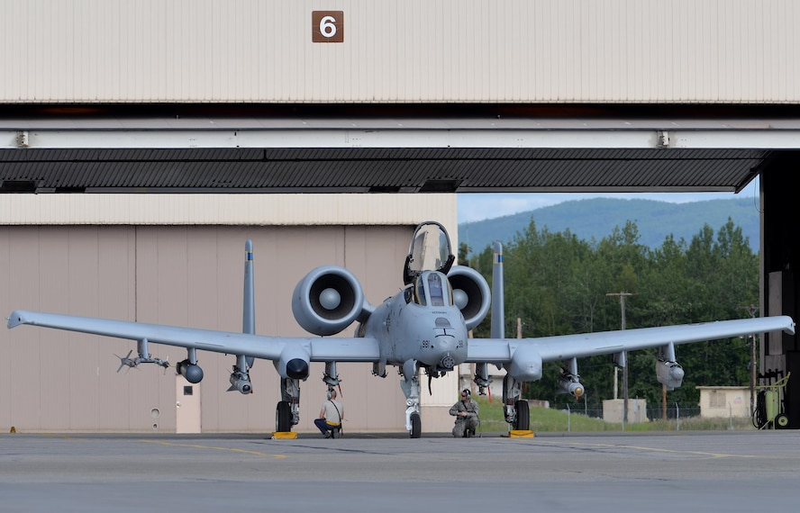 "U.S. Air Force maintenance Airmen wait to launch an A-10 Thunderbolt II twin-engine, ground-attack aircraft assigned to the 354th Fighter Squadron (FS) out of Davis-Monthan Air Force Base, Ariz., for an afternoon sortie from Eielson Air Force Base, Alaska, June 6, 2016, during RED FLAG-Alaska (RF-A) 16-2. RF-A is a series of Pacific Air Forces commander-directed field training exercises that enable U.S. and partner nation forces like the 354 FS ""Bulldogs"" to sharpen their combat skills by flying simulated combat sorties in a realistic threat environment inside the more than 67,000 square mile Joint Pacific Alaska Range Complex, the largest instrumented air, ground and electronic combat training range in the world. (U.S. Air Force photo by Master Sgt. Karen J. Tomasik/Released)"