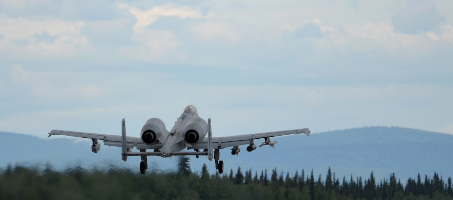 """A U.S. Air Force A-10 Thunderbolt II twin-engine, ground-attack aircraft assigned to the 354th Fighter Squadron (FS) out of Davis-Monthan Air Force Base, Ariz., takes off from the Eielson Air Force Base, Alaska, runway June 7, 2016, during RED FLAG-Alaska (RF-A) 16-2. RF-A is a series of Pacific Air Forces commander-directed field training exercises that enable U.S. and partner nation forces like the 354 FS """"Bulldogs"""" to sharpen their combat skills by flying simulated combat sorties alongside joint and international forces in a realistic threat environment inside the Joint Pacific Alaska Range Complex. (U.S. Air Force photo by Master Sgt. Karen J. Tomasik/Released)"""