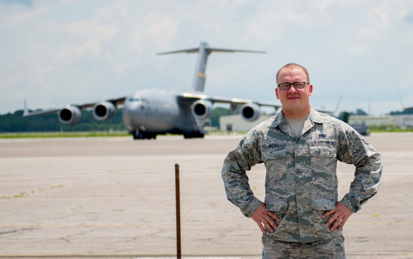 Airman 1st Class Evan Hittle, a 437th Aircraft Maintenance Squadron instrument and flight control systems specialist, stands in front of a C-17 Globemaster III aircraft at Joint Base Charleston, June 11, 2016. Hittle was five-years-old and his sister was seven when their parents passed away and they were orphaned in the Ukraine. A few years later, Hittle and his sister were adopted in the U.S. and transitioned to a new life. Hittle now plans to make the U.S. Air Force a career. (U.S. Air Force Photo/Airman Megan Munoz)