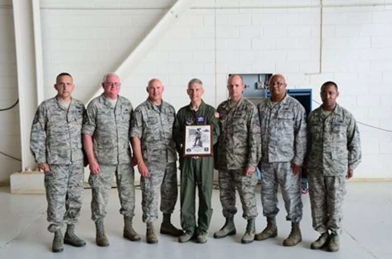 Maj. Gen. William O. Hill, Commander Mississippi Air National Guard, presents the Air National Guard Maintenance Effectiveness Award (small unit category) to 172d Maintenance Group at Thompson Field, Jackson, Miss., June 4, 2016. Pictured L-R, Chief Master Sgt. David Easterling, Chief Master Sgt. Raymond May, Chief Master Sgt. Norman Hatch, Maj. Gen. William O. Hill, Chief Master Sgt. Willis Allen, Senior Master Sgt. Clarence Hayes and Tech Sgt Telshaun Davis(Air Force photo by Tech. Sgt. Marvin B. Moore/Released)