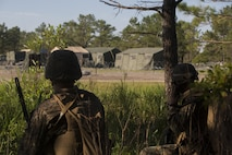 Marines with Kilo Company, 3rd Battalion, 6th Marine Regiment conduct reconnaissance before capturing the enemy operations center at Landing Zone Cardinal at Camp Lejeune, N.C., June 10, 2016. The battalion conducted a Marine Corps Combat Readiness Evaluation in preparation for the upcoming 24th Marine Expeditionary Unit slated in early 2017.