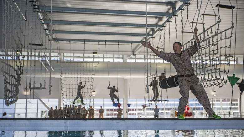 U.S. Marine Corps Sgt. Manuel Suarez, a squad leader, walks along a beam on an over-water obstacle course at Gallipoli Barracks, Queensland, Australia, June 7, 2016. The course is part of a three day period of sustainment training to keep Marines in good physical condition during Marine Rotational Force – Darwin. MRF-D is a six-month deployment of Marines into Darwin, Australia, where they will conduct exercises and train with the Australian Defence Forces, strengthening the U.S.-Australia alliance. Suarez, from Pixley, California, is with 1st Battalion, 1st Marine Regiment, MRF-D.