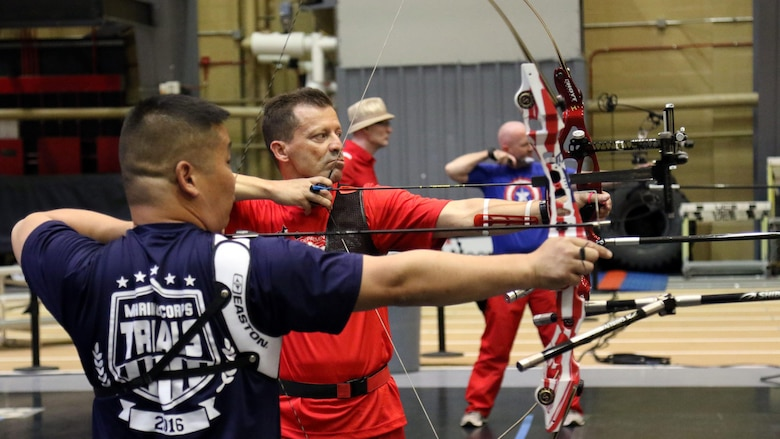 U.S. Marine Corps veteran Christopher McGleinnaiss, left, and Master Sgt. Mark Mann practice archery in preparation for the 2016 Department of Defense Warrior Games at the U.S. Military Academy at West Point, New York, June 13, 2016. McGleinnaiss, an Orinda, Calif., native, and Mann, a Salinas, Calif., native, are members of the 2016 DoD Warrior Games Team Marine Corps. The 2016 DoD Warrior Games is an adaptive sports competition for wounded, ill and injured Service members and veterans from the U.S. Army, Marine Corps, Navy, Air Force, Special Operations Command and the British Armed Forces.