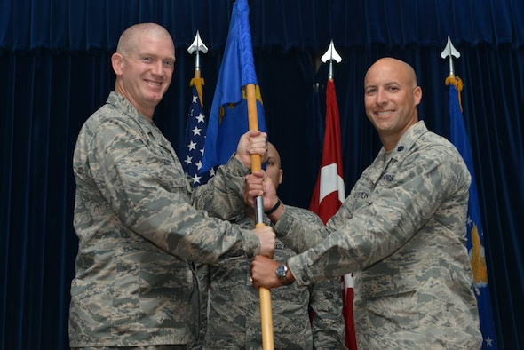 U.S. Air Force Lt. Col. Timothy Meerstein, 39th Communications Squadron incoming commander, receives command from U.S. Air Force Col. John Walker, 39th Air Base Wing commander, during a change of command ceremony June 14, 2016, at Incirlik Air Base, Turkey. Prior to taking command, Meerstein served as the chief of the operations division, communications and information directorate, Headquarters Air Force Special Operations Command, Hurlburt Field, Florida. (U.S. Air Force photo by Senior Airman John Nieves Camacho/Released)