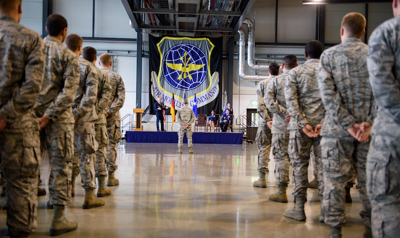 Airmen from the 521st Air Mobility Operations Wing listen to Maj. Gen. Frederick Martin, U.S. Air Force Expeditionary Center commander, at Ramstein Air Base, Germany, June 14, 2016. Martin was the presiding officer during the 521st AMOW change of command with Col. Thomas Cooper as he became the new commander. (U.S. Air Force photo/Staff Sgt. Armando A. Schwier-Morales)