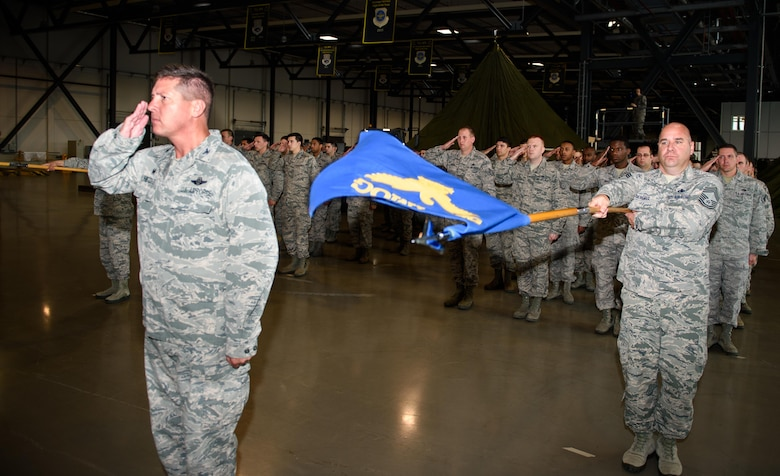 Airmen from the 521st Air Mobility Operations Wing give a final salute to the outgoing commander, Col. Nancy Bozzer, at Ramstein Air Base, Germany, June 14, 2016. Bozzer handed command to Col. Thomas Cooper during the change-of-command ceremony. (U.S. Air Force photo/Staff Sgt. Armando A. Schwier-Morales)