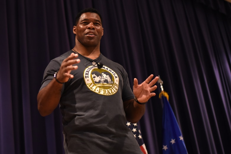 PETERSON AIR FORCE BASE, Colo. – Herschel Walker, retired NFL football player, speaks on resiliency to Team Pete in the base auditorium at Peterson Air Force Base, Colo. on June 8, 2016. Walker shared stories of his battle with Dissociative Identity Disorder in hopes to motivate service members to address their problems and get help to overcome them. (U.S. Air Force photo by Airman 1st Class Dennis Hoffman)