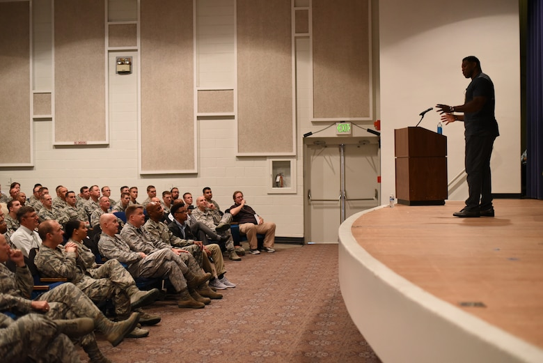 PETERSON AIR FORCE BASE, Colo. – Herschel Walker, retired NFL football player, speaks about resiliency to Team Pete in the base auditorium at Peterson Air Force Base, Colo. on June 8, 2016. Walker began his professional football career with the New Jersey Generals of the United States Football League before joining the Dallas Cowboys of the National Football League. (U.S. Air Force photo by Airman 1st Class Dennis Hoffman)
