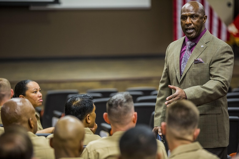 Marine Corps Base Camp Pendleton, Calif. -- Mr. Harrison Tanksley, Career Course Seminar chief instructor, College of Distance Education and Training, congratulates the staff sergeants of the first annual year class of Career Course Seminar on Camp Pendleton  May 26, 2016. To be eligible for promotion, staff sergeants are required to attend Career Course. (U.S. Marine Corps photo by Sgt. Tony Simmons/Released)