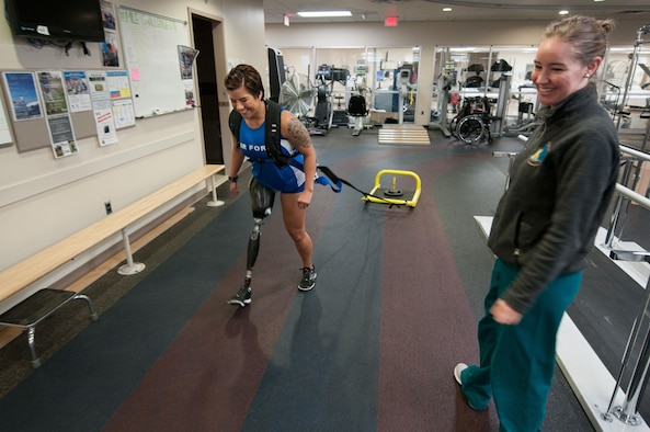 Staff Sgt. Sebastiana Lopez Arellano, a patient at Walter Reed National Military Medical Center, pulls a weighted sled around a track inside the center's Military Advanced Training Center, which provides amputee patients with state-of-the-art care, in Bethesda, Md., April 13, 2016. Lopez lost her right leg and suffered several other injuries in a motorcycle crash in 2015. She now uses sports and fitness as part of her physical and occupational therapy regimen. (U.S. Air Force photo/Sean Kimmons)