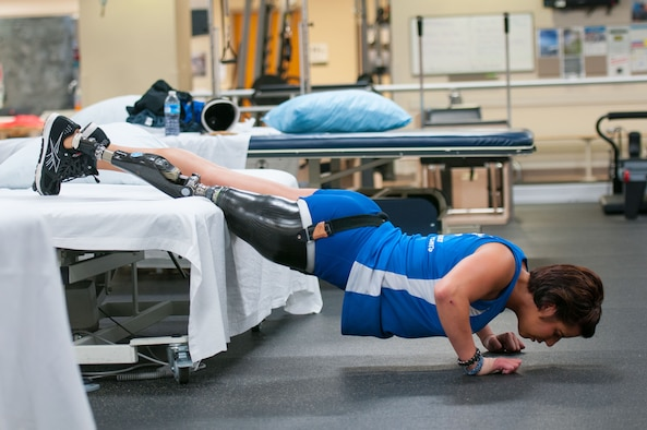 Staff Sgt. Sebastiana Lopez Arellano, a patient at Walter Reed National Military Medical Center, does pushups during her therapy session at the center's Military Advanced Training Center, which provides amputee patients with state-of-the-art care, in Bethesda, Md., April 13, 2016. Lopez lost her right leg and suffered several other injuries in a motorcycle crash in 2015. She now uses sports and fitness as part of her physical and occupational therapy regimen. (U.S. Air Force photo/Sean Kimmons)
