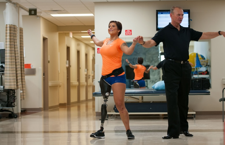 Staff Sgt. Sebastiana Lopez Arellano, a patient at Walter Reed National Military Medical Center in Bethesda, Md., learns some dance moves from volunteer Joe Kiballa on April 16, 2016. Lopez lost her right leg and suffered several other injuries in a motorcycle crash in 2015. She now uses sports and fitness as part of her physical and occupational therapy regimen. (U.S. Air Force photo/Sean Kimmons)