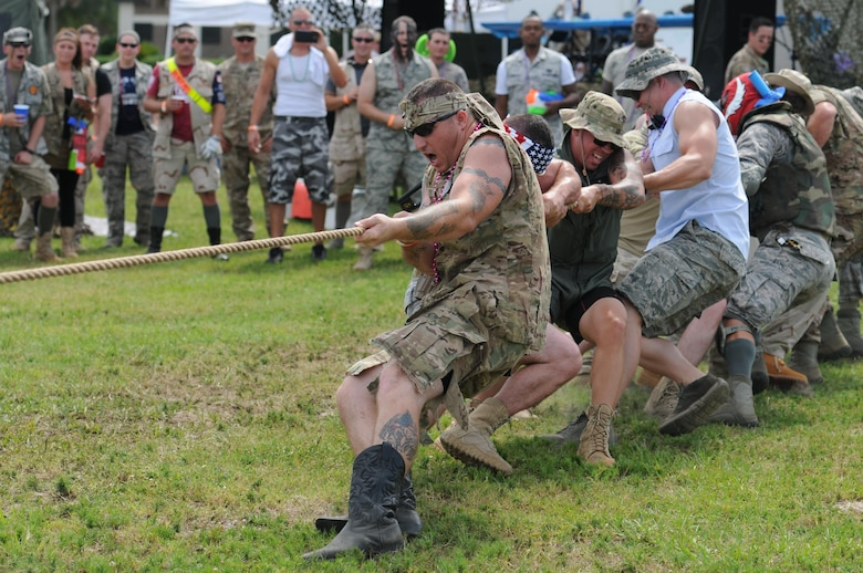 Members of the 81st Security Forces Squadron compete in the tug-of-war contest during the 81st Mission Support Group Combat Dining-In June 10, 2016, Keesler Air Force Base, Miss. The Combat Dining-In is a military tradition that promotes camaraderie and esprit de corps throughout the ranks. (U.S. Air Force photo by Kemberly Groue)