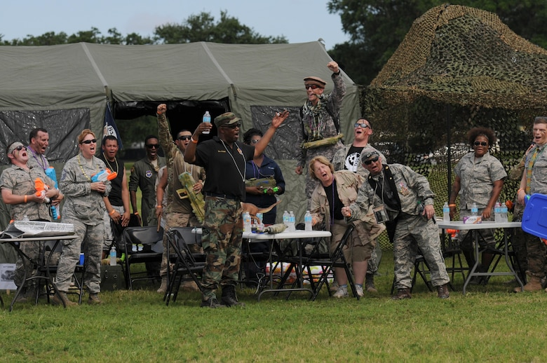 Members of the 81st Communications Squadron yell a chant for roll call during the 81st Mission Support Group Combat Dining In June 10, 2016, Keesler Air Force Base, Miss. The Combat Dining-In is a military tradition that promotes camaraderie and esprit de corps throughout the ranks. (U.S. Air Force photo by Kemberly Groue)