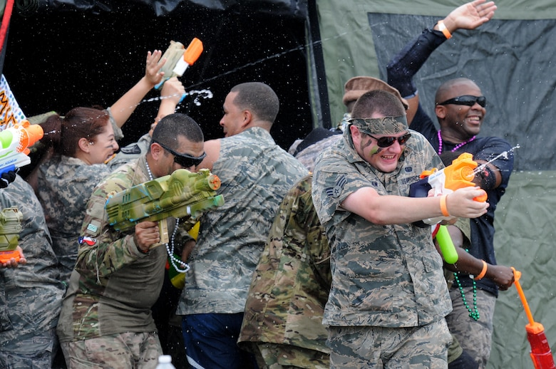 Members of the 81st Mission Support Group spray water during the 81st MSG Combat Dining In June 10, 2016, Keesler Air Force Base, Miss. The Combat Dining-In is a military tradition that promotes camaraderie and esprit de corps throughout the ranks. (U.S. Air Force photo by Kemberly Groue)
